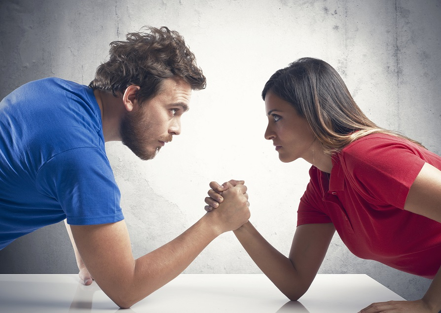 Arm wrestling challenge between a young couple